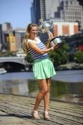 Виктория Азаренко, фото 214. Victoria Azarenka Posing with the Australian Open Trophy along the Yarra River in Melbourne - 29.01.2012, foto 214